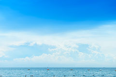 Blue sea and blue sky in cloudy day Royalty Free Stock Image