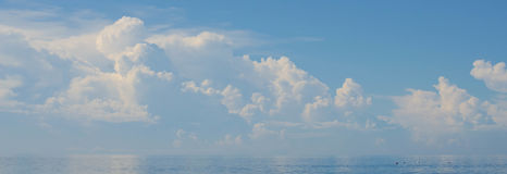 Blue Sea and Blue Sky and Long Cloud. Blue Sea and Blue Sky and Long Cloud in the sea Royalty Free Stock Image