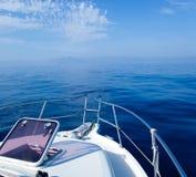 Blue sea boat sailing with open bow porthole Stock Photo