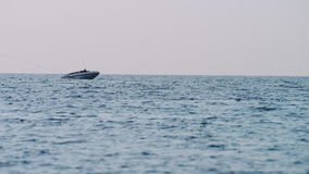 Blue sea and boat, slow motion. Blue sea and boat in Thailand stock video