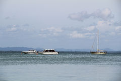 The blue sea with boats and blue cloudy sky, Thailand. Royalty Free Stock Images