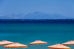 Blue sea and bright umbrellas. Greece, Kos Island Stock Image