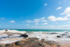 Blue sea of Cable Bay Northland New Zealand. Blue sky above scenic red sand and blue sea of Cable Bay Northland New Zealand Stock Image