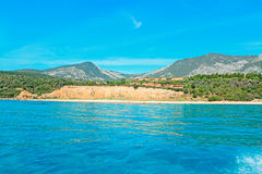 Blue sea in Cala Gonone shore. Cala Gonone shoreline on a clear day Stock Photography