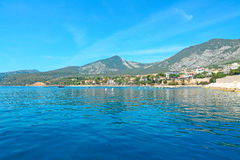 Blue sea in Cala Gonone. Cala Gonone shoreline on a clear day Royalty Free Stock Photo