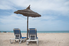 Blue Sea and chaise lounges Stock Photo