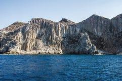 Blue sea and characteristic caves of Cala Luna Golfo di Orosei Sardegna or Sardinia Italy Stock Photography