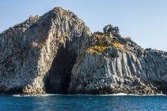 Blue sea and characteristic caves of Cala Luna Golfo di Orosei Sardegna or Sardinia Italy Royalty Free Stock Photos