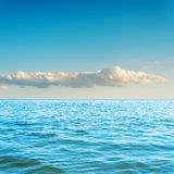 Blue sea and cloud in sky. Blue sea and low cloud in sky Royalty Free Stock Photography