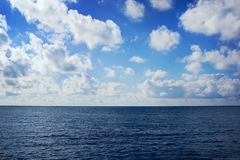 Blue sea with clouds Stock Photography