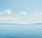 Blue sea and clouds Stock Images