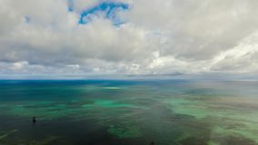 Blue sea and clouds in the Philippines. Hyperlapse. Cloud Hyperlapse with blue sea with atoll and coral reef. Timelapse at islands under the sky with clouds stock video footage