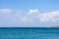 Blue sea, clouds in the sky.  Stock Photography
