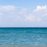 Blue sea, clouds in the sky.  Royalty Free Stock Image