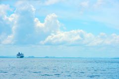 Blue sea and clouds on sky with big steamship Royalty Free Stock Photos