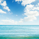 Blue sea and clouds in sky Royalty Free Stock Photos