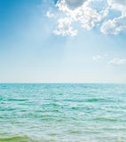 Blue sea and clouds Stock Photography