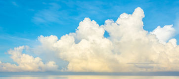 blue sea and cloudy blue sky over it. Stock Photos