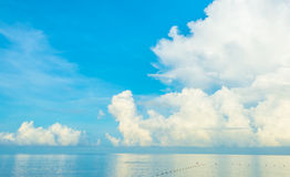 blue sea and cloudy blue sky over it. Royalty Free Stock Photography