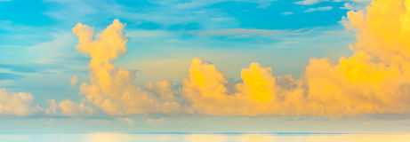 blue sea and cloudy blue sky over it. Royalty Free Stock Photo