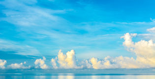 blue sea and cloudy blue sky over it. Royalty Free Stock Photos