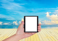 Blue sea and cloudy blue sky over it. Royalty Free Stock Image