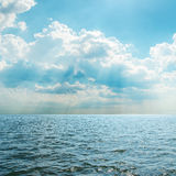 Blue sea and cloudy sky Stock Images
