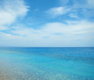 Blue sea and cloudy sky. Clear day Royalty Free Stock Images