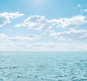 Blue sea and cloudy sky Stock Photo