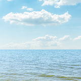 Blue sea and cloudy sky Stock Photos
