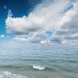 Blue sea and cloudy sky Stock Image