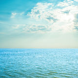 Blue sea and cloudy sky over it Royalty Free Stock Photography