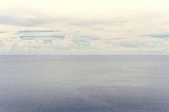 Blue sea and cloudy sky Royalty Free Stock Images
