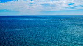 Blue sea and cloudy sky. Panoramic royalty free stock photos