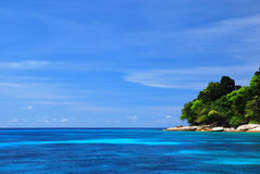 Blue Sea with coral reef and fluffy clouds from tachai island Royalty Free Stock Image