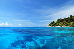 Blue Sea with coral reef and fluffy clouds from tachai island Royalty Free Stock Photography