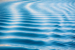 Blue sea curves Stock Photos