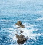 empty, brown cliffs in the water royalty free stock image