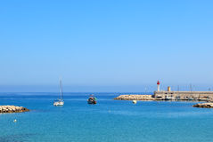 Blue sea at the entrance to marina of Menton, France. Stock Photography