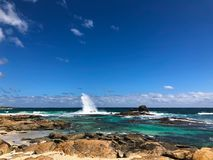 Blue sea with Granite boulders on Redgate Beach, Margaret River, royalty free stock images