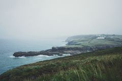 Blue Sea Beside Green Cliff during Daytime Royalty Free Stock Images