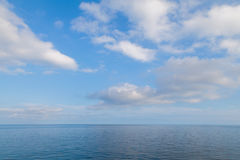 Blue sea horizon and sky with clouds Royalty Free Stock Image