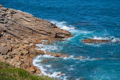 Blue sea landscape with waves against a rocky coast. Of northern Spain stock images