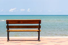 Blue sea,long wood chairs at the tropical beach on blue sky. Royalty Free Stock Photos