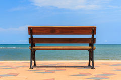 Blue sea,long wood chairs at the tropical beach. Royalty Free Stock Photos