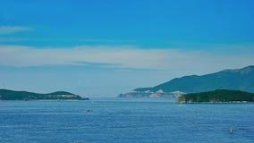 Blue Sea Near Mountains Stock Photos