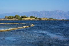 Blue sea near the mountains on Crete in Greece. In the sunny day Stock Image