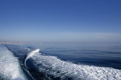 Blue sea ocean with boat wake Royalty Free Stock Photos