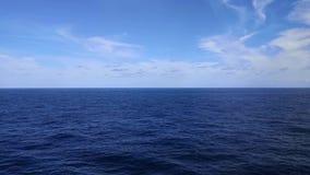 Blue sea, ocean, clouds and sky