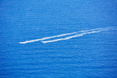 Blue sea ocean with watercrafts wake aerial Stock Photos